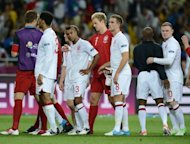 England's player react after being defeated after the Euro 2012 football championships quarter-final match England vs Italy at the Olympic Stadium in Kiev