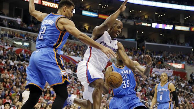 Los Angeles Clippers guard Chauncey Billups (1) loses the ball as Oklahoma City Thunder forward Thabo Sefolosha (2), of Switzerland, and forward Kevin Durant (35) defend in the first half of an NBA basketball game in Los Angeles, Sunday, March 3, 2013. (AP Photo/Reed Saxon)