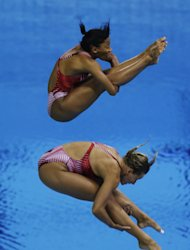 Bronze medalists Emilie Heymans, front, and Jennifer Abel, rear, from Canada, compete during the 3 Meter Synchronized Springboard final at the Aquatics Centre in the Olympic Park during the 2012 Summer Olympics in London, Sunday, July 29, 2012. (AP Photo/Lefteris Pitarakis)