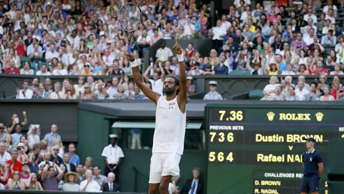 Dustin Brown of Germany celebrates a point during his match against Rafael Nadal of Spain at the Wimbledon Tennis Championships in London