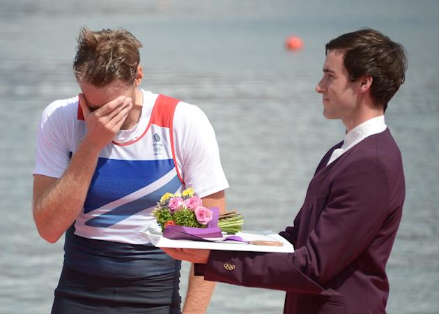 Great Britain's Alan Campbell cries as h