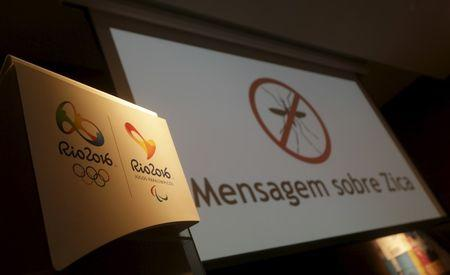 """Logos of the Rio 2016 Olympic Games and Rio 2016 Paralympic Games are pictured next to a message on a screen that reads """"Message about Zika"""" during a media briefing in Rio de Janeiro"""