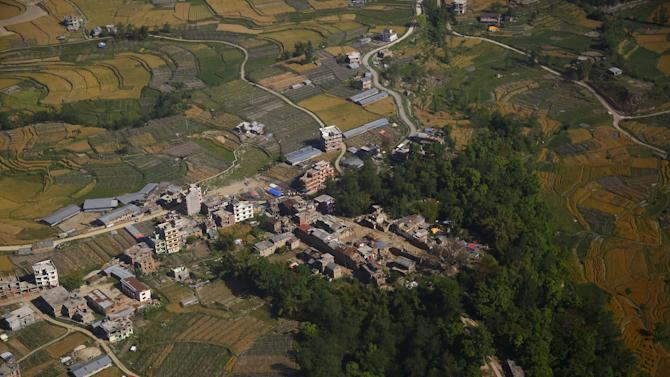 Collapsed houses are pictured from a helicopter after last week's earthquake at Sindhupalchok District