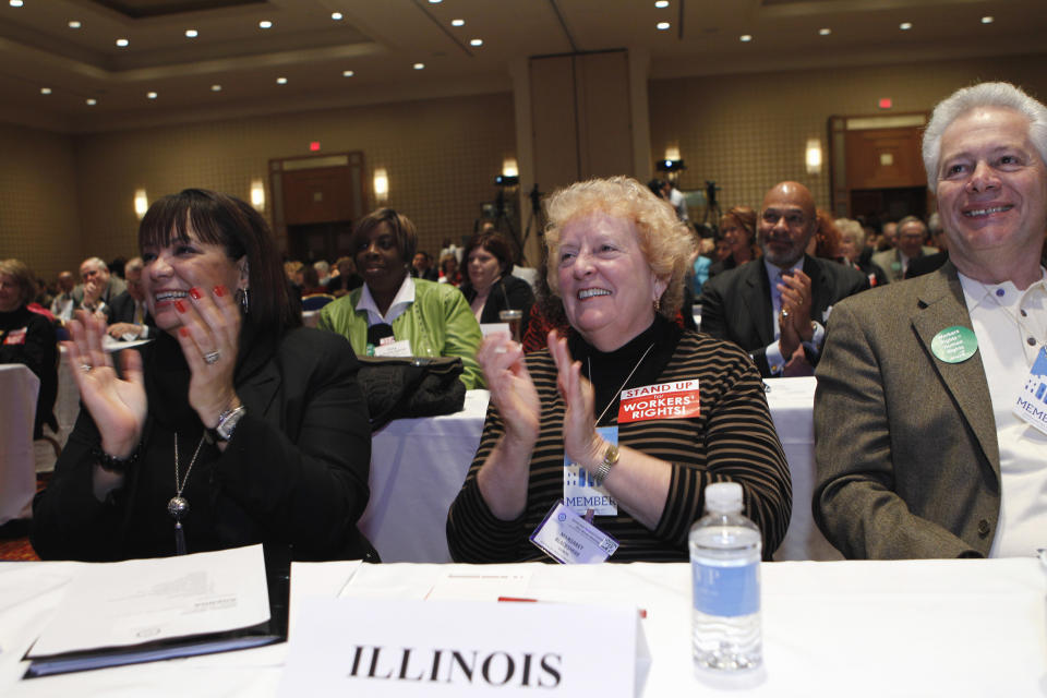 Former Illinois AFL-CIO President Margaret Blackshere, center, and other delegates, applaud after  White House Chief of Staff Bill Daley's address before the Democratic National Committee winter meeting in Washington, Saturday Feb. 26, 2011.(AP Photo/Jose Luis Magana)