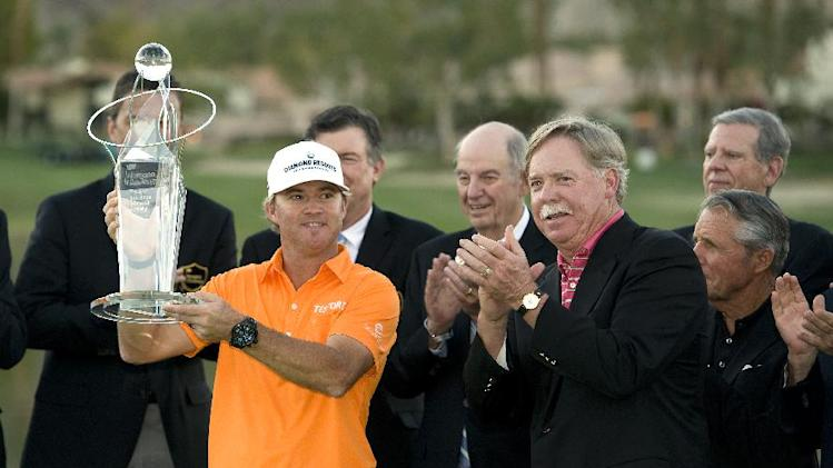 IMAGE DISTRIBUTED FOR HUMANA- 2013 Humana Challenge champion Brian Gay celebrates with Mike McCallister, Chairman of the Board of Humana and PGA Legend Gary Player as he lifts the Bob Hope Memorial Trophy at PGA West on Jan. 20, 2013, in La Quinta, Calif.  Gay, who won the trophy in a playoff against Charles Howell III and David Lingmerth, shot 25 under par. The 2013 Humana Challenge was held January 14-20 at PGA West in La Quinta, Calif. (Rodrigo Pena / AP Images for Humana)