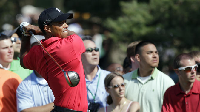 Tiger Woods tees off on the 15th hole during the during the final round of the Memorial golf tournament on Sunday, June 3, 2012, in Dublin, Ohio. Woods birdied the hole. (AP Photo/Jay LaPrete)
