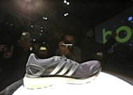 Attendees photograph the new Adidas Boost at the product launch in New York, February 13, 2013. REUTERS/Brendan McDermid