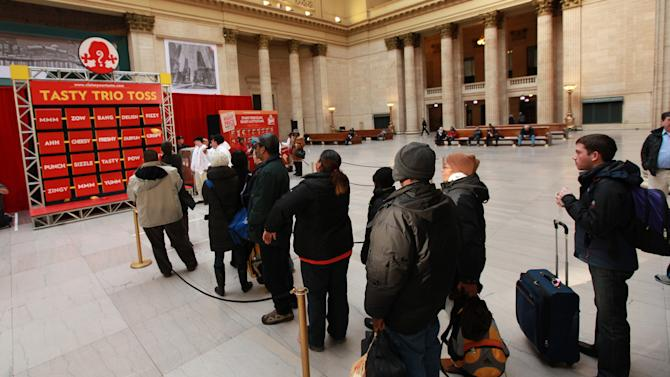 Consumers line up to experience Tasty Trio Toss at Wendy's ClaimYourTaste.com event at Union Station, on Tuesday, Jan. 15, 2013 in Chicago. (Photo by Barry Brecheisen/Invision for Wendy's/AP Images)