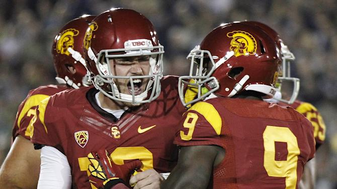 Southern California quarterback Max Wittek, left, celebrates with wide receiver Marqise Lee, right, after completing a touchdown pass to wide receiver Robert Woods against Notre Dame during the first half of an NCAA college football game, Saturday, Nov. 24, 2012, in Los Angeles. (AP Photo/Danny Moloshok)