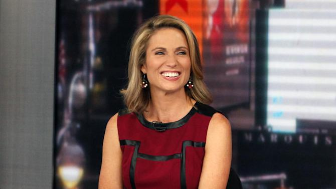 """This Sept. 13, 2013 photo released by ABC shows co-host Amy Robach during a broadcast of """"Good Morning America,"""" in New York. A month after undergoing a mammogram on """"Good Morning America,"""" ABC's Amy Robach said Monday, Nov. 11, she has breast cancer and will have a double mastectomy and reconstructive surgery this week. (AP Photo/ABC, Heidi Gutman)"""