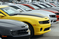 This Feb. 19, 2012 photo, shows a line 2012 Camaros at a Chevrolet dealership in the south Denver suburb of Englewood, Colo. U.S. factories stepped up production in February for the third straight month, helping the economy recover and driving the best job growth since the recession ended. (AP Photo/David Zalubowski)