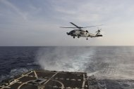 A US Navy SH-60R Seahawk helicopter takes off from the destroyer USS Pinckney in the Gulf of Thailand, to assist in the search for missing Malaysian Airlines flight MH370, in this March 9, 2014 handout picture. — Reuters pic