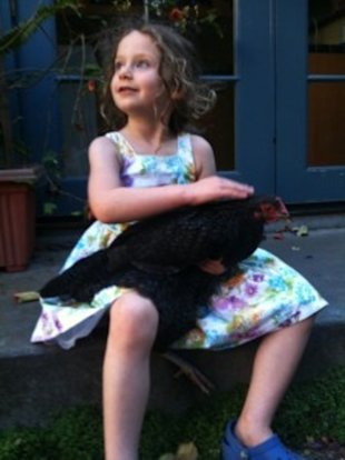 Marci Riseman's daughter Piper snuggles with Tallulah.