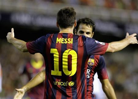 Barcelona's Messi celebrates with Fabregas after he scored against Valencia during their Spanish first division soccer match in Valencia