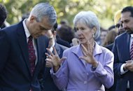 U.S. Health and Human Services Secretary Kathleen Sebelius talks with White House Chief of Staff Denis McDonough (L) during a healthcare event in the Rose Garden of the White House in Washington, October 21, 2013. REUTERS/Jason Reed