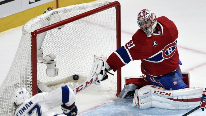 Tampa Bay Lightning defenseman Victor Hedman (77) scores his team's fourth goal against Montreal Canadiens goalie Carey Price (31) during second period of Game 2 NHL second round playoff hockey action, Sunday, May 3, 2015 in Montreal. (Ryan Remiorz/The Canadian Press via AP)