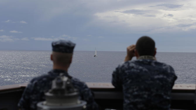 ADVANCED FOR USE SUNDAY FEB. 3 AND THEREAFTER In this Wednesday, Oct. 10, 2012 photo, U.S. Navy sailors look out at a small sailing vessel as the USS Underwood prepares to approach them while patrolling in international waters near Panama ,. In the most expensive initiative in Latin America since the Cold War, the U.S. has militarized the battle against drug traffickers, spending more than $20 billion in the past decade.  U.S. Army troops, Air Force pilots and Navy ships outfitted with Coast Guard counternarcotics teams are routinely deployed to chase, track and capture drug smugglers. (AP Photo/Dario Lopez-Mills)