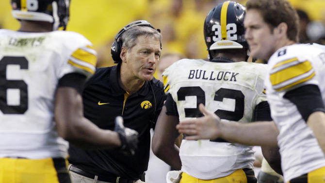 Iowa head coach Kirk Ferentz celebrates with running back Andre Dawson (32) after Dawson scored a touchdown during the second half of an NCAA college football game against Northern Illinois at Soldier Field in Chicago, Saturday, Sept. 1, 2012. Iowa won 18-17. (AP Photo/Nam Y. Huh)