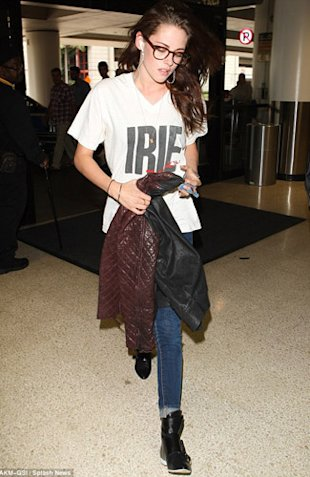 Kristen Stewart Arrives For Toronto Film Festival Wearing Robert Pattinson's IRIE T-shirt