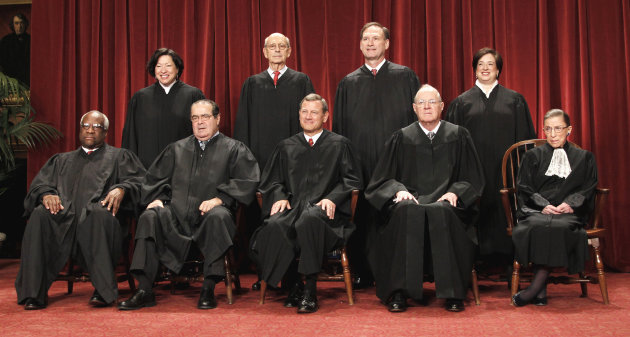 FILE - This Oct. 8, 2010 file photo shows the justices of the U.S. Supreme Court at the Supreme Court in Washington. Seated from left are Associate Justices Clarence Thomas, and Antonin Scalia, Chief Justice John Roberts, Associate Justices Anthony M. Kennedy and Ruth Bader Ginsburg. Standing, from left are Associate Justices Sonia Sotomayor, Stephen Breyer, Samuel Alito Jr., and Elena Kagan. The Supreme Court on Thursday, June 28, 2012, upheld the individual insurance requirement at the heart of President Barack Obama&#39;s historic health care overhaul. (AP Photo/Pablo Martinez Monsivais, File)