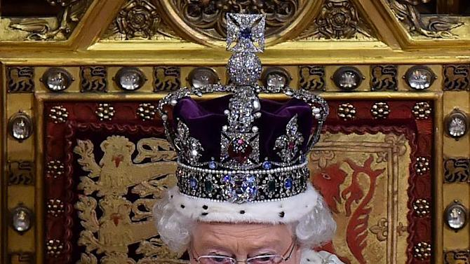 Britain's Queen Elizabeth II, seated on the throne in the House of Lords delivers the Queen's Speech during the State Opening of Parliament at the Palace of Westminster in London Wednesday, May 27, 2015. The State Opening of Parliament marks the formal start of the parliamentary year and the Queen's Speech sets out the government's agenda for the coming session. (Ben Stansall/Pool Photo via AP)