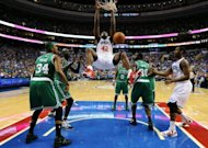 Philadelphia 76ers&#39; Elton Brand (C) dunks during the game against the Boston Celtics on May 23. Philadelphia rebounded from a 101-85 loss in game five by rallying in the second half to beat the favoured Celtics