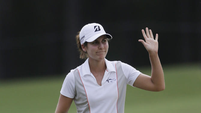 Jennifer Johnson waves to the crowd as she walks to the 18th green during the final round of the Mobile Bay LPGA Classic golf tournament at the Robert Trent Jones Golf Trail at Magnolia Grove in Mobile, Ala. Sunday, May 19, 2013. (AP Photo/Dave Martin)