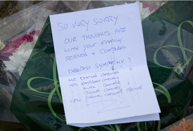 Floral tributes are seen outside the Royal Military Barracks, near the scene where a man was killed in Woolwich, southeast London