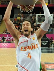 Spanish forward Pau Gasol scores during the men&#39;s basketball preliminary round match Spain vs Brazil as part of the London 2012 Olympic Games at the Basketball Arena in London. Brazil defeated Spain 88-82
