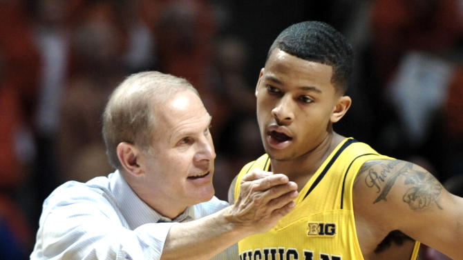 Michigan head coach John Beilein talks to Trey Burke (3) during the second half of their NCAA college basketball game against Illinois, Sunday, Jan. 27, 2013, in Champaign, Ill. Michigan won 74-60. (AP Photo/John Dixon)