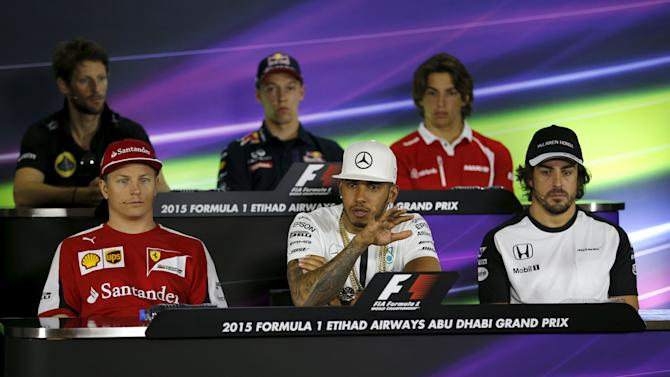 Mercedes Formula One driver Hamilton speaks as other drivers look on during driver's news conference at Yas Marina circuit before start of Abu Dhabi Grand Prix