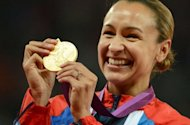 Gold medalist Britain&#39;s Jessica Ennis poses on the podium of the heptathlon at the athletics event during the London 2012 Olympic Games