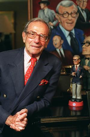 "FILE - This Oct. 6, 1996 file photo shows Irving Fein, long time manager of the late George Burns, standing near memorabilia up for auction at Sotheby's, in Beverly Hills, Calif.  Fein, a producer and manager who steered the careers of George Burns and Jack Benny and nicknamed actress Lana Turner ""the Sweater Girl,"" died Aug. 10, 2012 of an age-related illness.  He was 101. (AP Photo/Frank Wiese, file)"