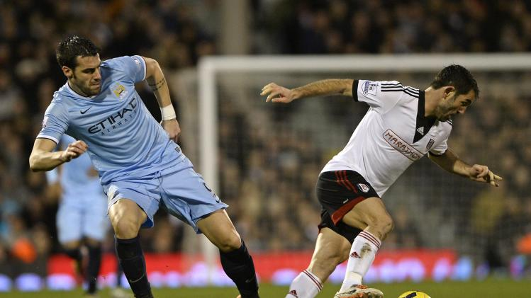 Fulham's Giorgos Karagounis is challenged by Manchester City's Alvaro Negredo during their English Premier League soccer match in London