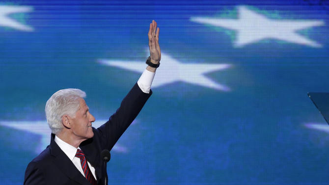 Former President Bill Clinton waves to the delegates before addressing the Democratic National Convention in Charlotte, N.C., on Wednesday, Sept. 5, 2012. (AP Photo/J. Scott Applewhite)