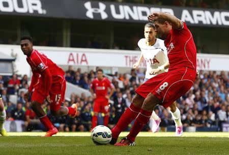 Liverpool's Gerrard scores his team's second goal from a penalty during their English Premier League soccer match against Tottenham Hotspur at White Hart Lane in London