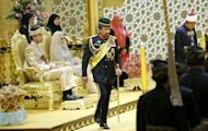 Brunei's Sultan Haji Hassanal Bolkiah (centre) returns after blessing the royal couple Princess Hajah Hafizah Sururul Bolkiah and her groom Pengiran Haji Muhammad Ruzaini in Bandar Seri Begawan