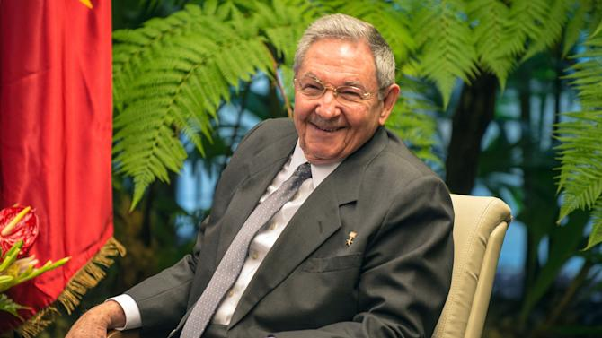 FILE - In this March 27, 2014 file photo, Cuba's President Raul Castro smiles during a meeting with Vietnam's Prime Minister Nguyen Tan Dung at Revolution Palace in Havana, Cuba. Castro is marking his 83rd birthday privately on Tuesday, June 3, 2014, a milestone that is passing without fanfare. Castro has said he intends to remain in office no longer than his current term, which ends in 2018. (AP Photo/Adalberto Roque, Pool, File)