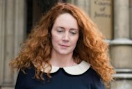 "Former Chief Executive of News International Rebekah Brooks leaves the High Court in central London. British Prime Minister David Cameron signed texts to ex-Rupert Murdoch aide Brooks ""lots of love"" and privately discussed the News of the World scandal with her, she told an inquiry"
