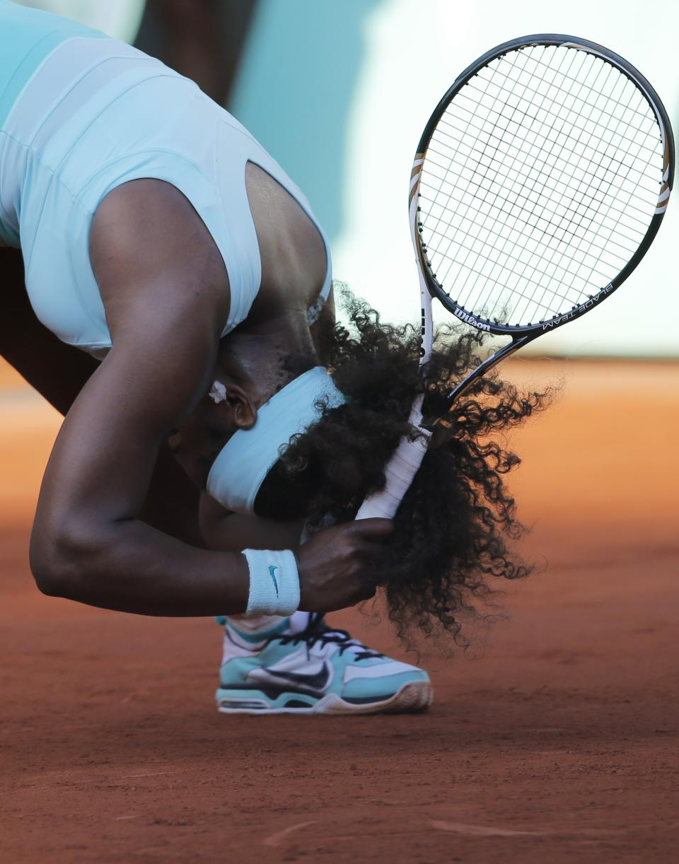 USA's Serena Williams reacts as she plays France's Virginie Razzano during their first round match in the French Open tennis tournament at the Roland Garros stadium in Paris, Tuesday, May 29, 2012. (AP Photo/Christophe Ena)