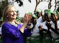 US Secretary of State Hillary Clinton (L) sings and applauds with Malawian women at the Lumbadzi Milk Bulking Group on August 5 in Lilongwe, Malawi. Clinton met Nelson Mandela on Monday at his rural homestead where South Africa's first black president is living out retirement