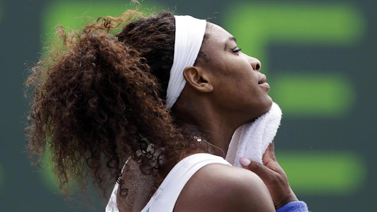 Serena Williams wipes her face during during a match against Dominika Cibulkova, of Slovakia, during the Sony Open tennis tournament, Monday, March 25, 2013, in Key Biscayne, Fla. (AP Photo/Lynne Sladky)
