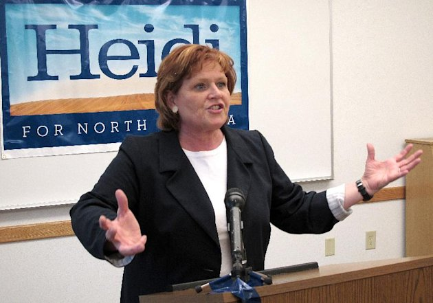 FILE - In this May 3, 2012, file photo, North Dakota Democratic Senate candidate Heidi Heitkamp speaks in Minot, N.D. North Dakota's prosperity from an energy boom as the rest of the country slowly crawls out from under a collapsed economy four years ago is making a contest of a Senate race that Democrats had all but conceded. (AP Photo/Dale Wetzel, File)