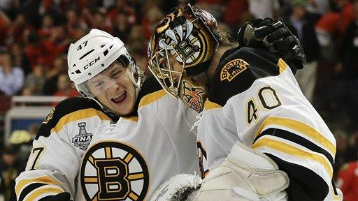 Bruins beat Blackhawks 2-1 in OT, even Cup series