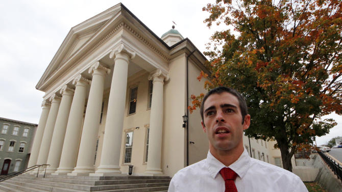 """Joshua Harper, of State College, Pa.,  a member of the Jerry Sandusky jury, stands in front of the Centre County Courthouse in Bellefonte, Pa., on Friday, Oct. 5, 2012.  Harper, who has bachelor's and master's degrees from Penn State, said that he takes pride in having served on the jury, and that the guilty verdict was not a close call. He wants Sandusky """"put away for the rest of his life, really.""""(AP Photo/Gene J. Puskar)"""