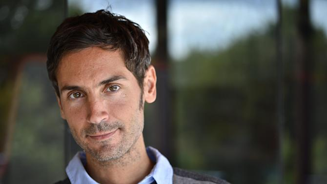 """FILE - An Aug. 20, 2012 photo from files showing Swedish Academy Award-winning documentary filmmaker Malik Bendjelloul. Police in Sweden say the film director behind the Oscar-awarded music documentary """"Searching for Sugarman,"""" Malik Bendjelloul died Tuesday, May 13, 2014. He was 36. Police spokeswoman Pia Glenvik said Bendjelloul died in Stockholm late Tuesday, but wouldn't specify the cause of death. She said no crime is suspected in relation to the Swedish film maker's death. (AP Photo/TT, Anders Wiklund, File) SWEDEN OUT"""