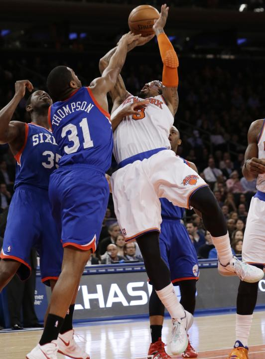 New York Knicks' J.R. Smith (8) is fouled by Philadelphia 76ers' Hollis Thompson (31) during the first half of an NBA basketball game Monday, March 10, 2014, in New York. (AP Photo/Frank Frank