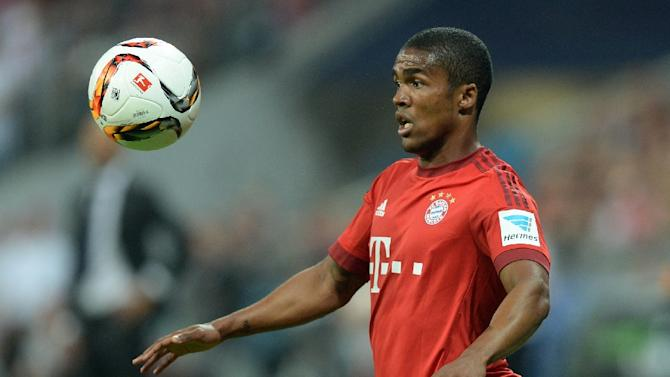 Bayern Munich's Brazilian midfielder Douglas Costa plays the ball during their Bundesliga match against Bayern Munich at the Allianz Arena in Munich on August 14, 2015