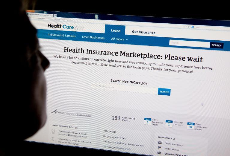 A woman looks at the HealthCare.gov insurance exchange internet site October 1, 2013 in Washington, DC