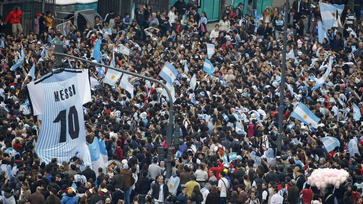 Argentina's fans wait for the arrival of Argentina's national soccer team in downtown Buenos Aires